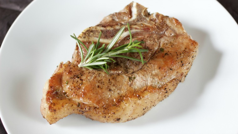 Searing and roasting these herbed pork chops give them great flavor - perfect served with tomato jam and balsamic reduction!