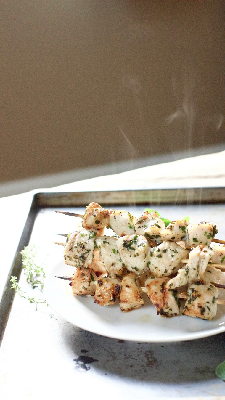 These grilled chicken skewers are served with a fresh taste of summer – garden herbs galore!
