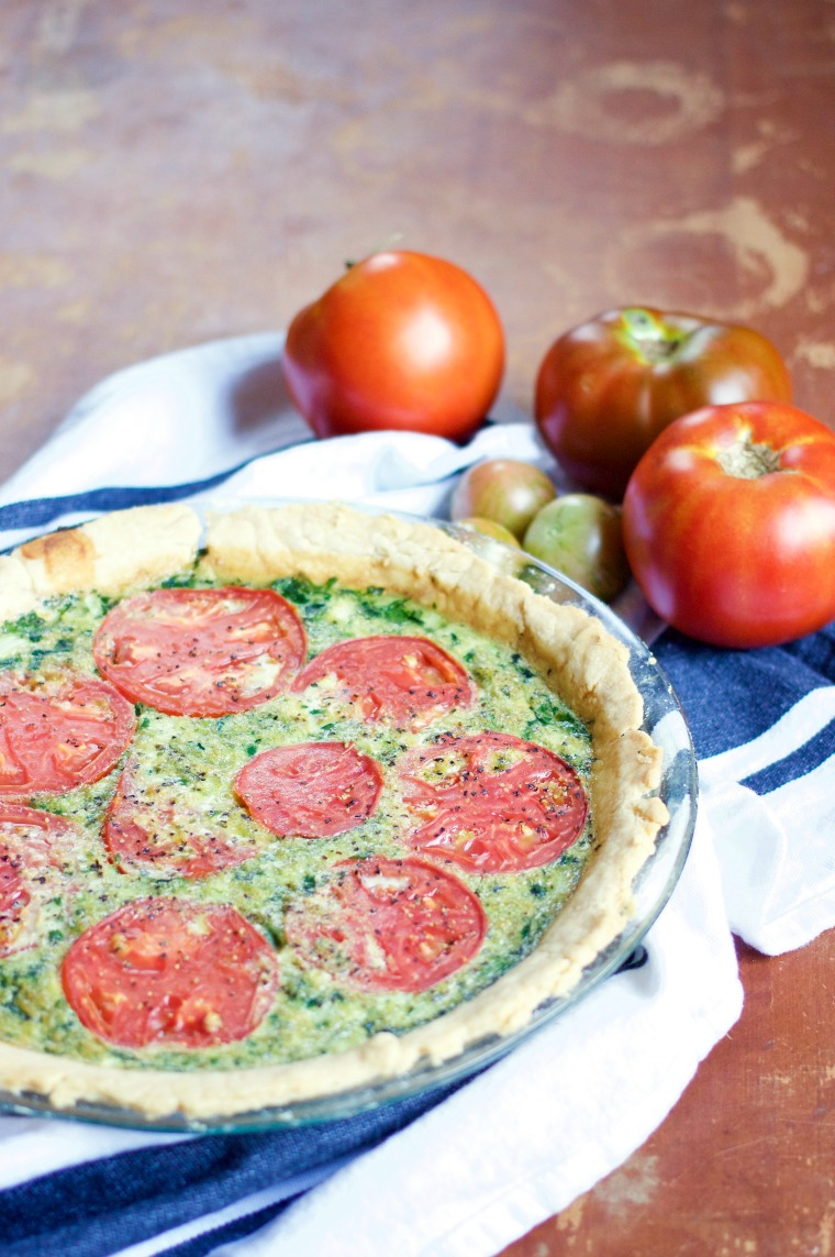 This dairy-free tomato and pesto quiche is savory in all the best ways – a great way to use up your fresh garden tomatoes and basil!