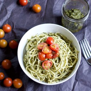 This dairy-free basil pesto with fresh tomatoes is so flavorful that you don't even miss the cheese!