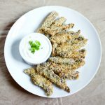 Bake up these mushroom fries with a creamy lemon-garlic dipping sauce for a crunchy appetizer or party pleaser!
