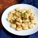 Eating acorn squash gnocchi with brown butter and crispy garlic will warm your heart and bring the autumn season straight into your kitchen.