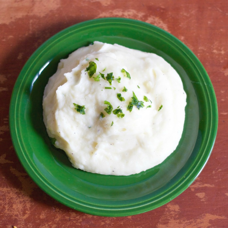 My dad's mashed potatoes are simple but different - completely smooth and packed with lots of dairy to give them a super creamy texture!