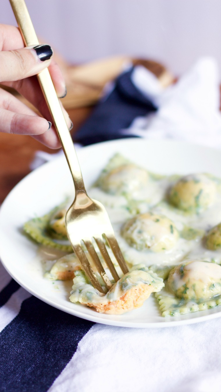This spinach ravioli with browned butter cream sauce is filled with delicious things! You can't go wrong!