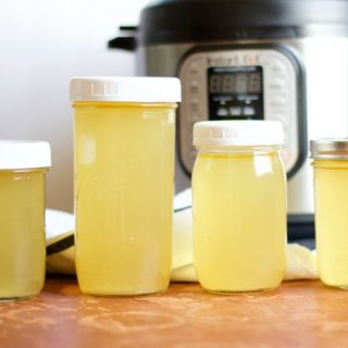 four jars of broth in different sizes