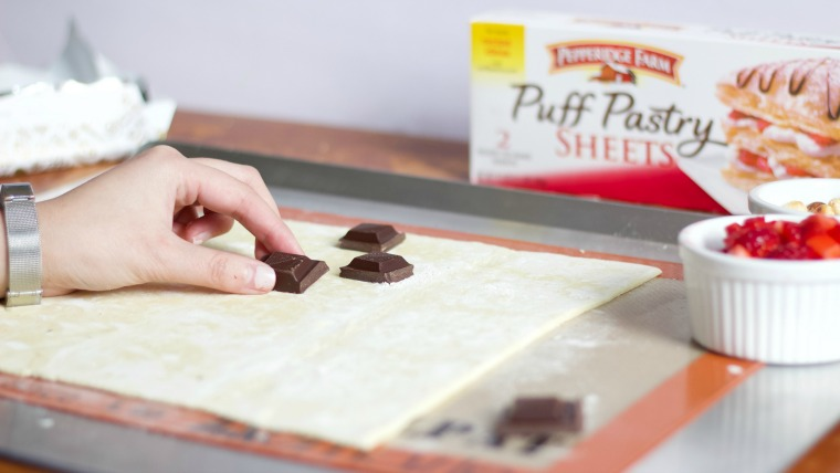 placing chocolate onto a puff pastry