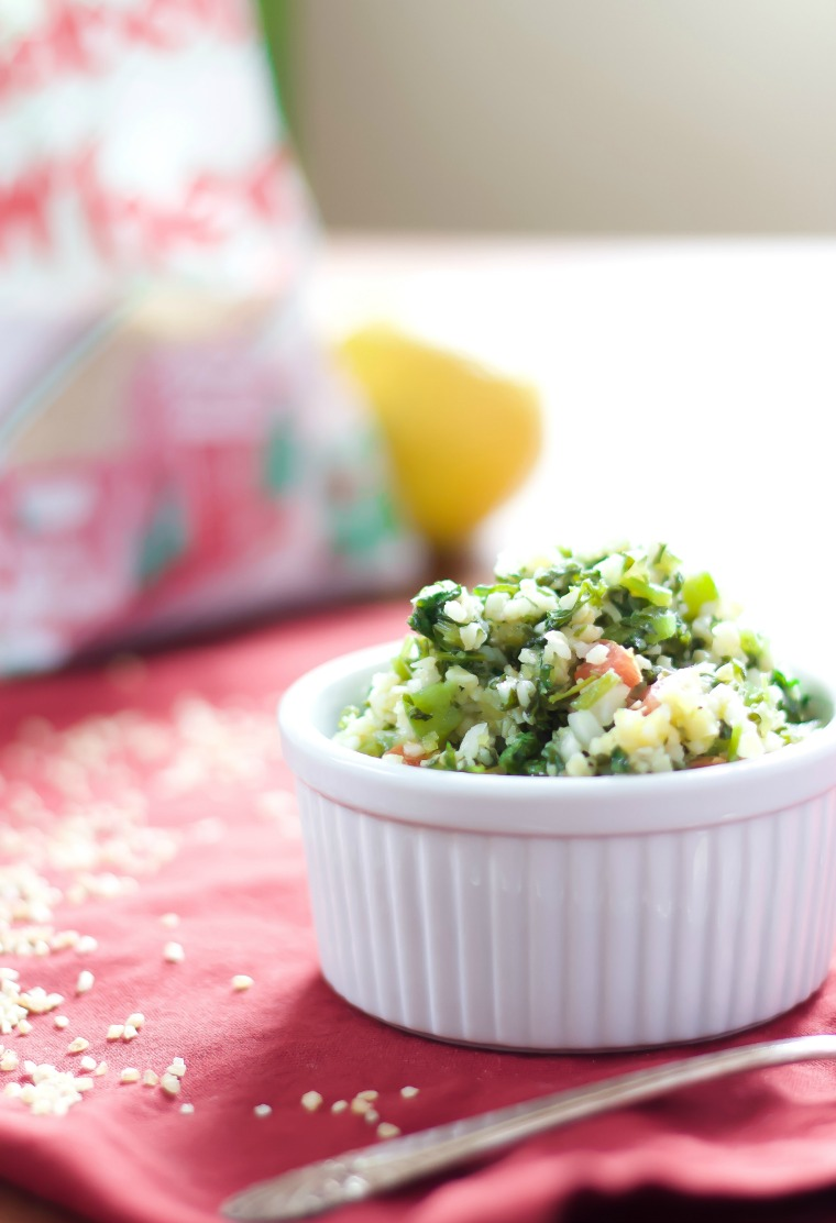 side view of a cup full of tabouli