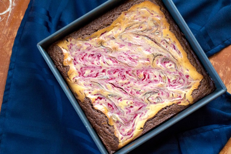 overhead shot of a square pan of cheesecake brownies