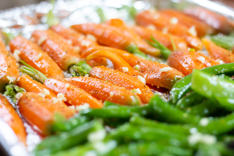 close up of a pan of vegetables, primarily carrots, ready to go into the oven.