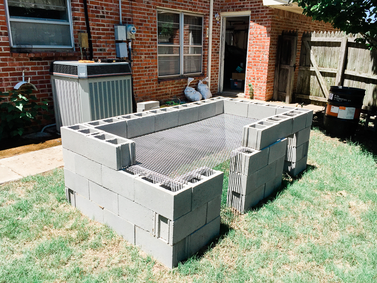a half-built temporary roasting pit