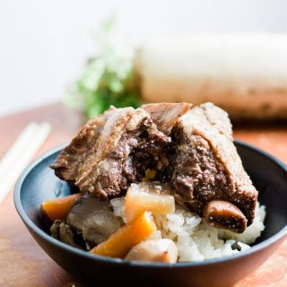 close up of a bowl of galbi jjim served over white rice