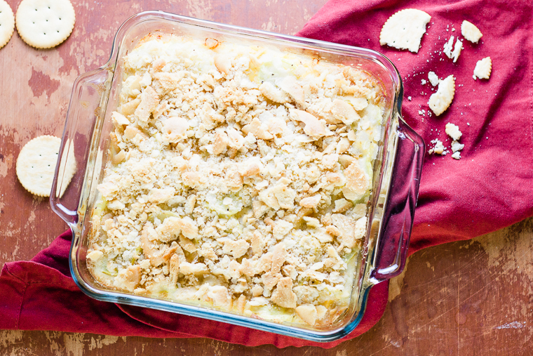 overhead view of a square pan of yellow squash casserole