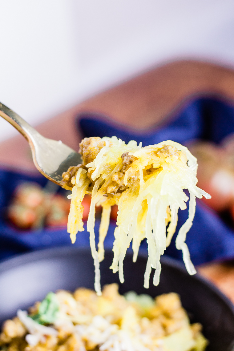 a fork full of spaghetti squash bolognese
