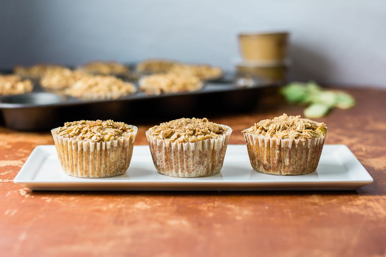 a plate with three oatmeal cup muffins