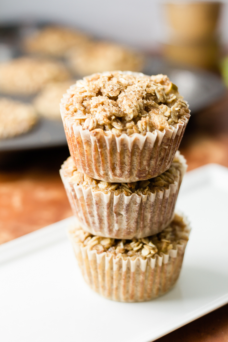a plate with three oatmeal cup muffins in a stack