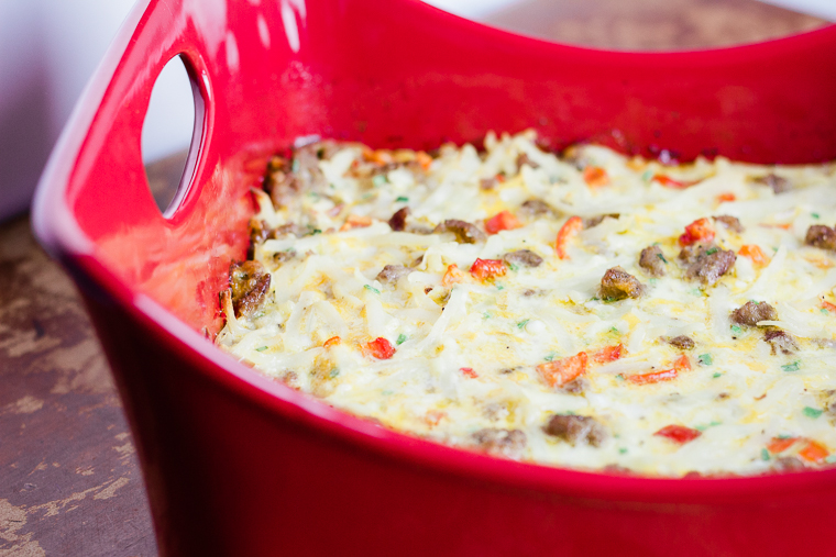 a side angle of a square pan full of breakfast casserole
