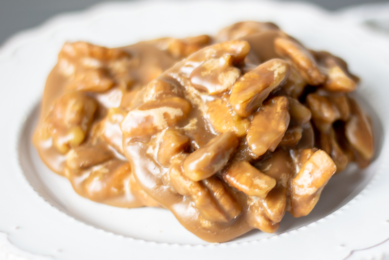 close up on a pecan praline on a plate