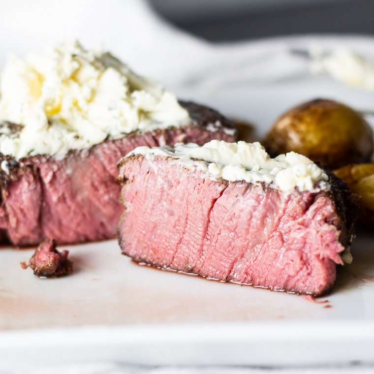 a closeup of the inside of a sous vide filet with gournay cheese on top