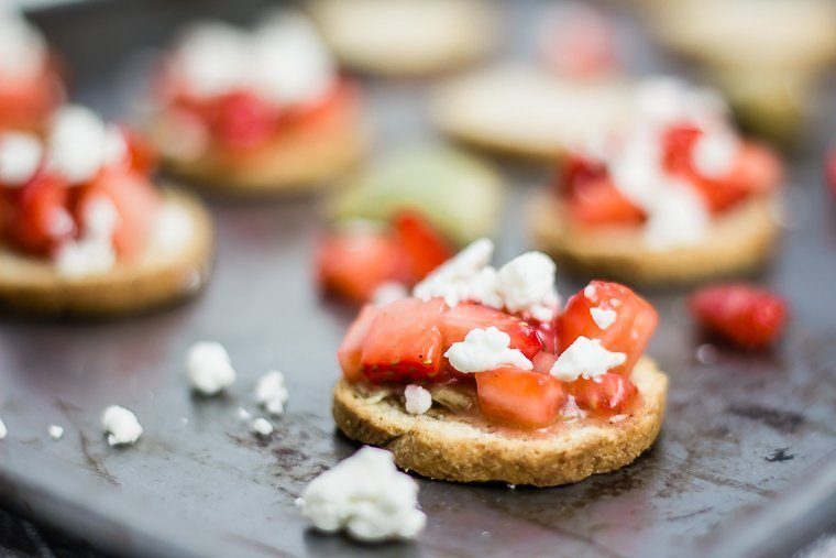a close up on a slice of strawberry bruschetta