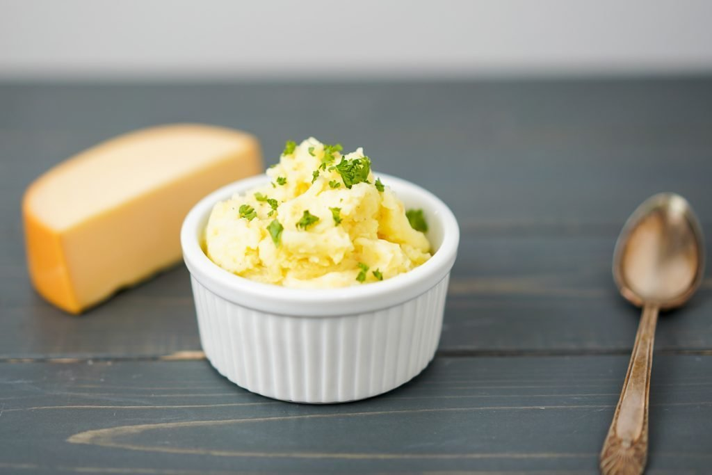 smoked gouda mashed potatoes in a small ramekin garnished with parsley